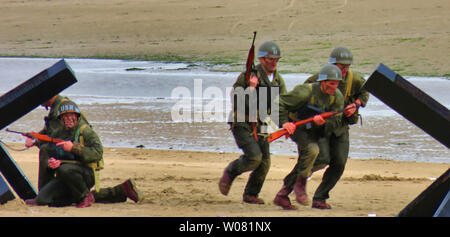 UTAH, FRANCE - June 06, 2019. Special forces men in camouflage uniforms on beach. Diversionary mission for D-Day 75 birthday, end of world war two - Stock Photo