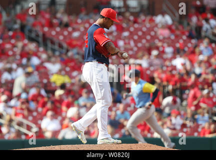 Tampa Bay Rays Logan Morrison rounds third base after hitting a solo home run while St. Louis Cardinals pitcher Sam Tuivailala tries to regroup in the tenth inning at Busch Stadium in St. Louis on August 27, 2017. Tampa Bay defeated St. Louis, 3-2.      Photo by Bill Greenblatt/UPI - Stock Photo