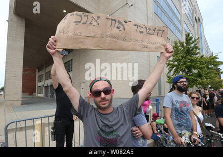 A protester holds a sign in Hebrew during a peaceful protest outside of St. Louis Metropolitian Police Headquarters in St. Louis on September 17, 2017. A non-guilty verdict of a former white St. Louis policeman in the 2011 shooting of a black man in St. Louis has resulted in two nights of peaceful marching eventually turning violent. Jason Stockley was acquitted of first degree murder charges in the fatal shooting of Anthony Lamar Smith on Dec. 11, 2011 following a high-speed chase. Police have made nearly 50 arrests while a score of businesses have suffered broken windows.   Photo by Bill Gre - Stock Photo