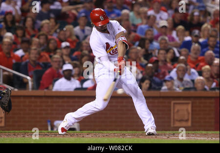 St. Louis Cardinals Randal Grichuk swings hitting a RBI triple in the first inning against the Chicago Cubs at Busch Stadium in St. Louis on September 26, 2017. Photo by Bill Greenblatt/UPI - Stock Photo