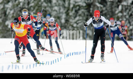 Winners of the women's pursuit of the FIS World Cup Cross Country, sprinting to the finish, Marit Bjoergen of Norway (L) gold, and Beckie Scott of Canada (R) silver at Vernon, British Columbia's Sovereign Lake, December 10, 2005.   (UPI Photo / Heinz Ruckemann) - Stock Photo