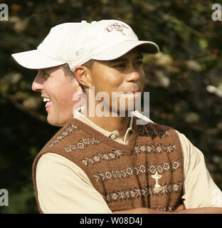 Tiger Woods of team USA laughs with teammate Phil Mickelson during the afternoon practice round at the K club in Straffan September 21 2006. (UPI Photo/Hugo Philpott) - Stock Photo