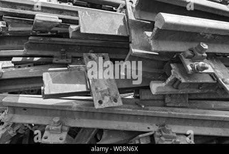 old rusty railroad tracks in black and white - Stock Photo
