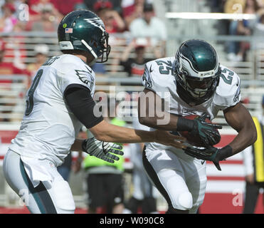Philadelphia Eagles QB Nick Foles hands off to RB LeSean McCoy in the third quarter against the San Francisco 49ers at Levi's Stadium in Santa Clara, California on September 28, 2014. The 49ers defeated the Eagles 26-21.  UPI/Terry Schmitt - Stock Photo