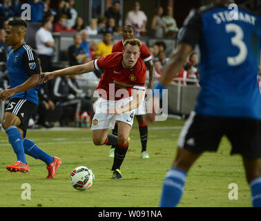 Manchester United's Phil Jones (4) looks to pass against the San Jose Earthquakes in the first half in the 2015 International Champions Cup North America at Avaya Stadium in San Jose, California on July 21, 2015. Manchester defeated San Jose 3-1.    Photo by Terry Schmitt/UPI - Stock Photo