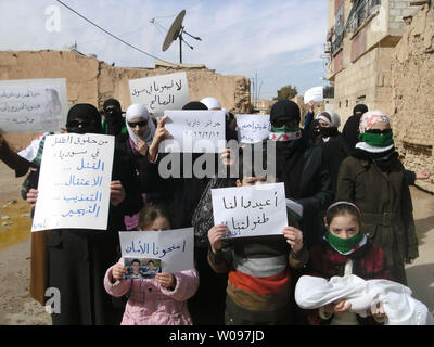 Syrian women and children demonstrate against Syria's President Bashar al-Assad in Daria, near Damascus, on February 12, 2012.   Syrian forces resumed their bombardment of the city of Homs on Monday after Arab countries called for U.N. peacekeepers and pledged their firm support for the opposition battling President Bashar al-Assad.   UPI - Stock Photo