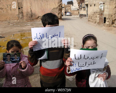 Children take part in a protest against Syria's President Bashar al-Assad in Daria, near Damascus, February 12, 2012. Syrian forces resumed their bombardment of the city of Homs on Monday after Arab countries called for U.N. peacekeepers and pledged their firm support for the opposition battling President Bashar al-Assad.   UPI - Stock Photo
