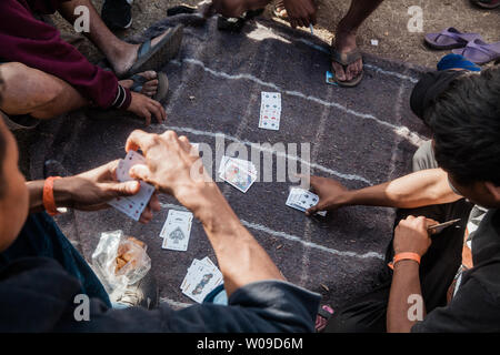 Men play cards at Benito Juarez migrant shelter in Tijuana, Mexico to help pass the time on November 28, 2018.  Photo by Ariana Drehsler/UPI - Stock Photo