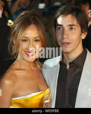 Justin Long (R) and Maggie Q. pose for cameras during the red carpet ceremony premiere of  the movie 'Live Free or Die Hard'  in Tokyo on June 12, 2007. (UPI Photo/Keizo Mori) - Stock Photo