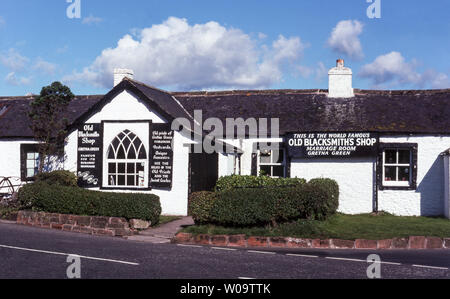 Scotland. Gretna Green's 'Old Blacksmith Shop' where  runaway marriages have been performed since 1754 AD.The 'First and Last'  house in Scotland. - Stock Photo