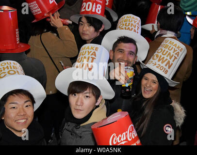 People pose for camera during the event for 2018 new year's countdown at Shibuya district shopping street in Tokyo, Japan on December 31, 2017.     Photo by Keizo Mori/UPI - Stock Photo