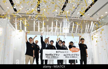 (L2-R2)Makoto Takahashi, President of KDDI Corporation, Japanese actors Ryunosuke Kamiki and Honoka Matsumoto celebrate during a launch event for Apple New iPhone Xs and Xs Max at the KDDI's au Shinjuku store in Tokyo, Japan, on September 21, 2018.     Photo by Keizo Mori/UPI - Stock Photo