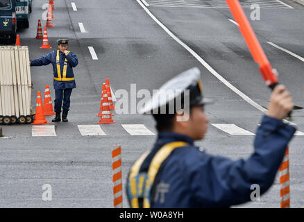 Member of Tokyo metropolitan police officer stand guard around the Imperial Palace on the day Emperor Akihito abdicates in Tokyo, Japan on April 30, 2019.     Photo by Keizo Mori/UPI - Stock Photo