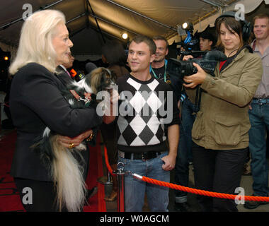 Screen legend Lauren Bacall talks to television reporters on the red carpet as she arrives with her dog Sophie for the Toronto International Film Festival gala premiere of 'The Walker' at Roy Thomson Hall in Toronto, Canada on September 13, 2007. (UPI Photo/Christine Chew) - Stock Photo
