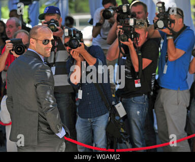 Actor Jason Statham poses for photographers as he arrives for the gala screening of 'Killer Elite' at Roy Thomson Hall during the Toronto International Film Festival in Toronto, Canada on September 10, 2011.  UPI/Christine Chew - Stock Photo