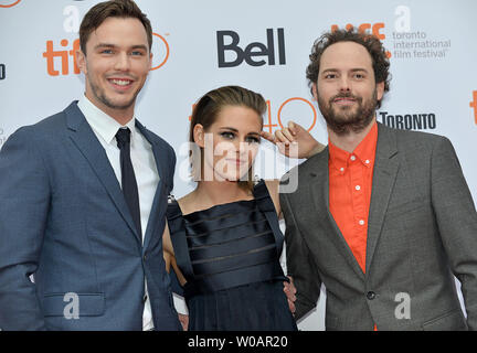 (L-R) Nicholas Hoult , Kristen Stewart and director Drake Doremus arrive at the Toronto International Film Festival premiere of 'Equals' at the Princess of Wales theatre in Toronto, Canada on September 13, 2015. Photo by Christine Chew/UPI - Stock Photo