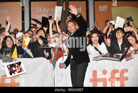 Matthias Schoenaerts waves and signs autographs for fans as he arrives for the premiere of 'Kursk' at the Princess of Wales Theatre on opening night of the 43rd Toronto International Film Festival in Toronto, Canada on September 6, 2018. Photo by Christine Chew/UPI - Stock Photo