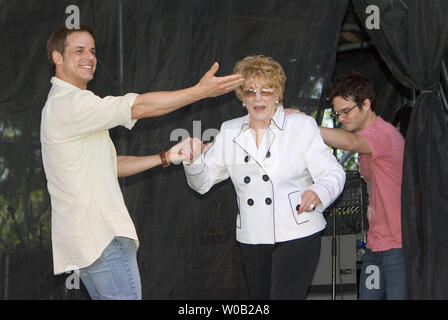 Stars of soap opera The Young and the Restless , (L to R), Emmy winner Christian Leblanc, (plays Michael Baldwin) and six time best actress nominee Jeanne Cooper (plays Katherine Chancellor) and Emmy winner Kevin Rikaart (plays Kevin Fisher) arrive for a Q & A with fans before their next function as special guests of the official Pacific National Exhibition opening day celebration parade in Vancouver, August 20, 2005.  (UPI Photo/Heinz Ruckemann) - Stock Photo