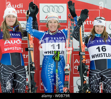 Celebrating on the podium are Nadia Styger from Switzerland in first place, flanked by Lindsey Vonn from the USA in second place (L) and teammate Julia Mancuso in third place in the women's Downhill of Telus presents FIS World Cup Skiing at Whistler, British Columbia, February 22, 2008. The races are also testing conditions for alpine skiing events at Whistler for the 2010 Winter Olympics. (UPI Photo/Heinz Ruckemann) - Stock Photo