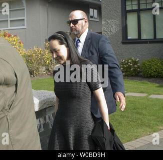 Huawei CFO Meng Wanzhou wearing a GPS tracker and ankle bracelet is