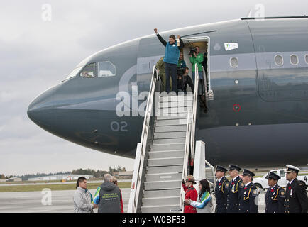 Vancouver Mayor Gregor Robertson celebrates bringing home the Olympic Flame as he disembarks a Canadian Forces CC 150 Polaris (Airbus A-310) aircraft upon arriving from Athens, Greece at Victoria International Airport where Canadian Prime Minister Stephen Harper, British Columbia (BC) Premier Gordon Campbell and other dignitaries wait to welcome the Flame to Canada for the start of the 2010 Winter Olympic Torch Relay in Victoria, BC, October 30, 2009. UPI /Heinz Ruckemann - Stock Photo