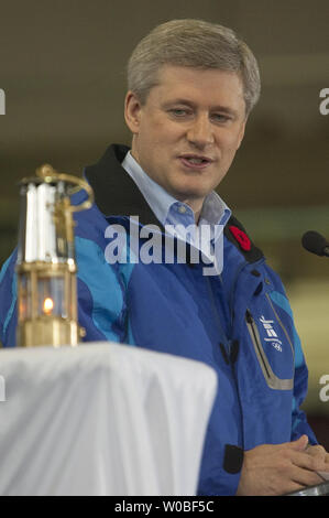 Canadian Prime Minister Stephen Harper speaks while looking at the Olympic Flame housed in a miners lantern which arrived earlier on a Canadian Forces CC 150 Polaris (Airbus A-310) aircraft from Athens, Greece at Victoria International Airport where the Flame is welcomed to Canada for the start of the 2010 Winter Olympic Torch Relay in Victoria, BC, October 30, 2009. UPI /Heinz Ruckemann - Stock Photo