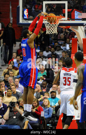 Detroit Pistons center Andre Drummond (0) dunks the ball against Washington Wizards power forward Trevor Booker (35) in the first half at the Verizon Center in Washington, D.C. on December 28, 2013.   UPI/Mark Goldman - Stock Photo
