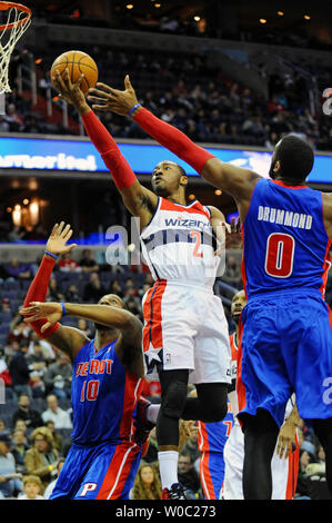 Washington Wizards point guard John Wall (2) scores against Detroit Pistons center Andre Drummond (0) in the first half at the Verizon Center in Washington, D.C. on January 18, 2014.   UPI/Mark Goldman - Stock Photo