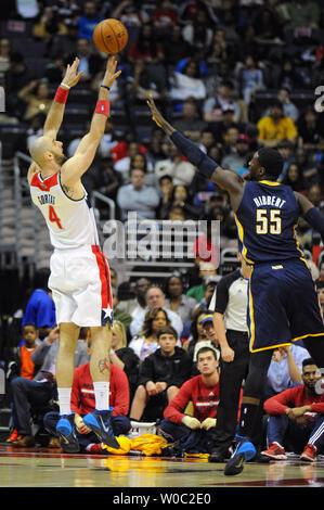 Washington Wizards center Marcin Gortat (4) scores against Indiana Pacers center Roy Hibbert (55) Center in Washington, D.C. on March 28, 2014.   UPI/Mark Goldman - Stock Photo