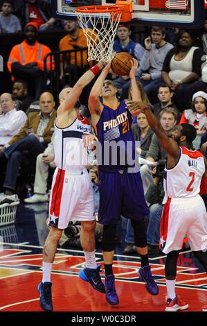 Phoenix Suns center Alex Len (21) scores against Washington Wizards center Marcin Gortat (4) in the first half at the Verizon Center in Washington, D.C. on December 21, 2014.   UPI/Mark Goldman - Stock Photo
