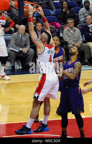Washington Wizards center Marcin Gortat (4) scores against Phoenix Suns forward Markieff Morris (11) in the first half at the Verizon Center in Washington, D.C. on December 21, 2014.   UPI/Mark Goldman - Stock Photo