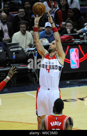 Washington Wizards center Marcin Gortat (4) scores against the Houston Rockets in the first half at the Verizon Center in Washington, D.C. on March 29, 2015.   Photo by Mark Goldman/UPI - Stock Photo