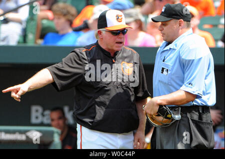 Baltimore Orioles manager Buck Showalter (26) talks with the home plate umpire Andy Fletcher (49) after a close play at first base against the New York Yankees in the third inning at Orioles Park at Camden Yards in Baltimore, MD. on June 14, 2015.   UPI/Mark Goldman