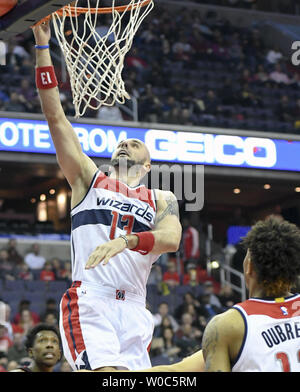 Washington Wizards center Marcin Gortat (13) scores in the first half against the Miami Heat in the first half at the Verizon Center in Washington, D.C. on April 8, 2017.   Photo by Mark Goldman/UPI - Stock Photo