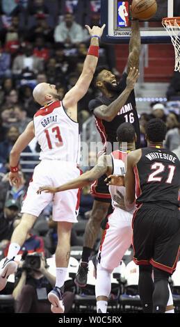 Miami Heat forward James Johnson (16) scores against Washington Wizards center Marcin Gortat (13) in the first half at the Verizon Center in Washington, D.C. on April 8, 2017.   Photo by Mark Goldman/UPI - Stock Photo