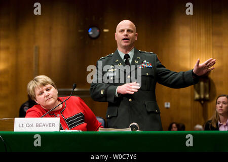 Lt. Col. James Friend (R), council to Lt. Col. Diane Beaver (Ret. U.S. Army) (L), former staff judge advocate for the Joint task Force 170/JTF Guantanamo Bay, objects to the line of questioning during a Senate Armed Services Committee hearing on the origins of aggressive interrogation techniques and treatment of detainees in U.S. Custody on Capitol Hill in Washington on June 17, 2008. (UPI Photo/Patrick D. McDermott) - Stock Photo
