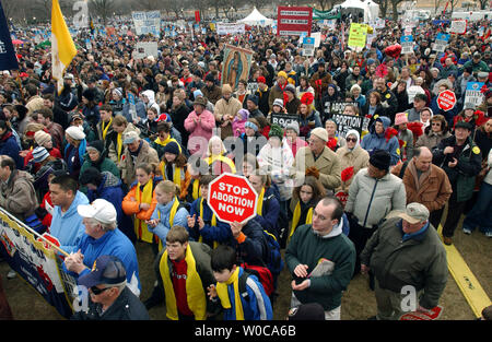 Thousands of protestors assemble to march against abortion rights on January 22, 2004, in Washington. This is the 31st annual march held on the anniversary of the Supreme Court decision Roe vs. Wade which legalized abortions across the U.S.   (UPI Photo/Roger L. Wollenberg) - Stock Photo