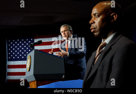 President George W. Bush, guarded by the secret service, addresses the U.S. Hispanic Chamber of Commerce on March 24, 2004, at the Renaissance Hotel in Washington. Bush defended his record on the economy and the war against terrorism.    (UPI Photo/Roger L. Wollenberg) - Stock Photo