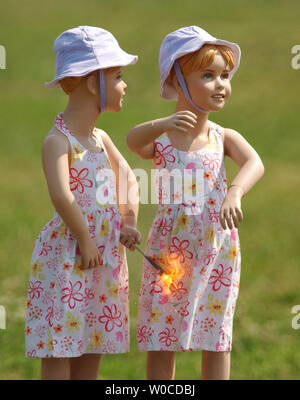 The Consumer Product Safety Commission shows how even sparklers can be dangerous when young children play with them, as these manequin show when one of their dresses is lit on fire, on June 30, 2004 in Washington.  The demonstration was set up to prevent fireworks related accidents on the fourth of July. (UPI Photo/Michael Kleinfeld) - Stock Photo