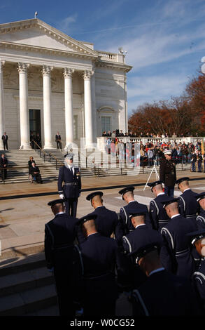 Members of the U.S. Coast Guard Ceremonial Honor Guard march into position during a ceremony for Veterans Day at the Tomb of the Unknowns at Arlington National Cemetery on November 11, 2004. President Bush later said that even at that moment, troops were fighting in Iraq, and that all Americans should remember and know the sacrifice the men and women in the United States armed services make to preserve freedom at home and abroad. (UPI Photo/Michael Kleinfeld) - Stock Photo