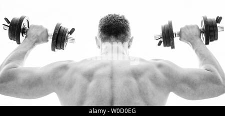Pain is temporary, pride is forever. Sportsman with strong back and arms. Sport equipment. Bodybuilding sport. Sport lifestyle. Dumbbell exercise gym. Muscular man exercising with dumbbell rear view. - Stock Photo