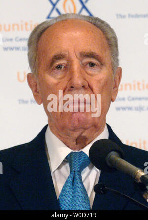 The Deputy Prime Minister of Israel Shimon Peres speaks on the rebuilding of northern Israel at a press conference in Washington on August 16, 2006. The rebuilding campaign is being coordinated by the United Jewish Communities and other local Jewish foundations. (UPI Photo/Kevin Dietsch) - Stock Photo