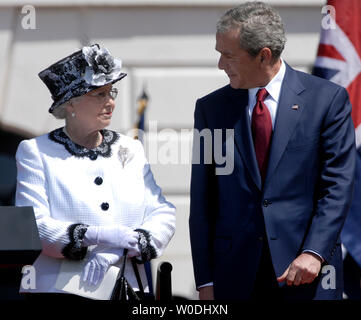 Britain's Queen Elizabeth II looks to U.S. President George W. Bush, during an arrival ceremony at The White House in Washington on May 7, 2007.The Queen is on the final leg of her six day visit to America. (UPI Photo/Kevin Dietsch) Stock Photo