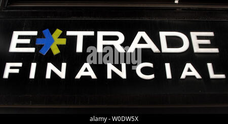 The E-Trade Financial sign is seen on their branch in Washington on August 22, 2007. Shares of E-Trade Financial Corp rose after a report said the online broker has been discussing a possible merge with TD Ameritrade Holding Corp. (UPI Photo/Kevin Dietsch) - Stock Photo