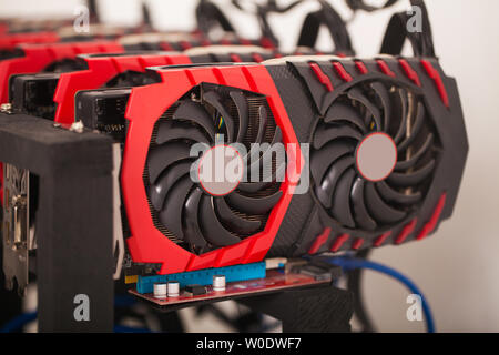 Cryptocurrency background mining rig , Close up of array of GPUs for mining rig machine to mine for digital cryptocurrency such as bitcoin, ethereum - Stock Photo