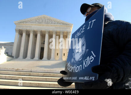 An anti-abortion protester demonstrates in front of the U.S. Supreme Court as part of an American Life League (ALL) protest to bring attention to the 35th anniversary of the Roe vs. Wade Supreme Court case, which made abortions legal in the United States, in Washington on January 21, 2008. (UPI Photo/Kevin Dietsch) - Stock Photo