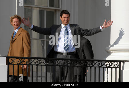 Boston Red Sox Pitcher Josh Beckett reacts to the crowd as he ascends the South Portico of the White House, after U.S. President George W. Bush honored the 2007 World Series Champions, in Washington on February 27, 2008. Pitcher Kyle Snyder (L) walks past. (UPI Photo/Alexis C. Glenn) - Stock Photo