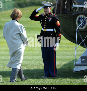 A Marine salutes as First Lady Laura Bush prepares to embark on Marine One as she and U.S. President George W. Bush depart the White House en route to Camp David for the weekend in Washington on March 20, 2008.   (UPI Photo/Roger L. Wollenberg) - Stock Photo