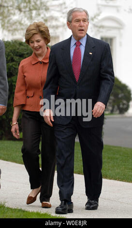 U.S. President George W. Bush and First Lady Laura Bush arrive for a ceremonial tree planting on the North Lawn of the White House in Washington on April 9, 2008.    (UPI Photo/Roger L. Wollenberg) - Stock Photo