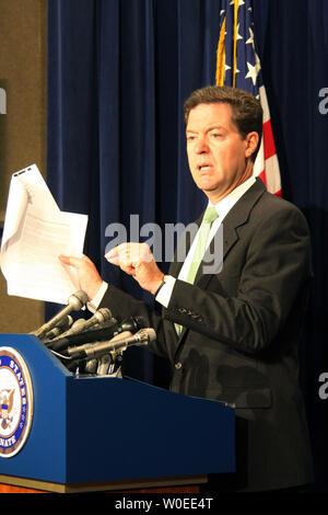 Sen. Sam Brownback (R-KS) holds up documents containing allegations that the Chinese government installed equipment in foreign-owned hotels in Beijing enabling them to spy on guests during the Olympics this August, in Washington on July 29, 2008. (UPI Photo/Jack Hohman) - Stock Photo